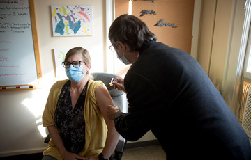 person receiving a flu shot
