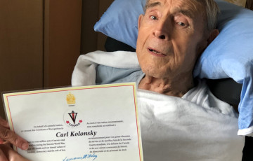Carl with certificate of recognition for D-Day